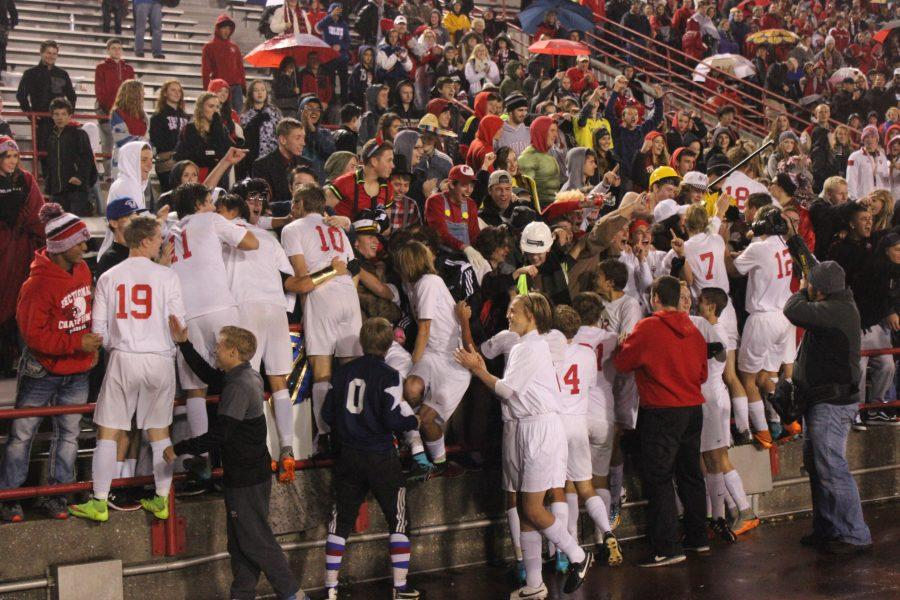 The+boys+soccer+team+races+to+celebrate+with+the+student+section+after+defeating+Lafayette+Harrison+4-0+in+the+state+game.+
