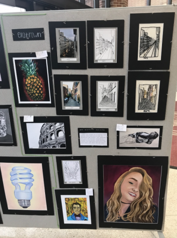 """Most of these are part of my concentration,"" senior Ella Brown said. ""And this one is my self portrait which I worked hard on this year."""