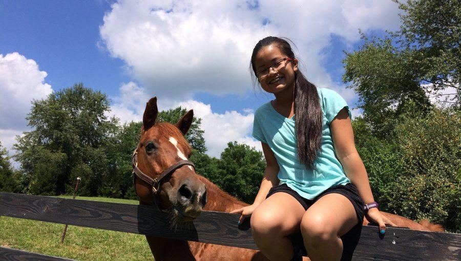 Sophomore+spends+time+volunteering+at+Pine+Meadows+Horse+and+Rescue+center