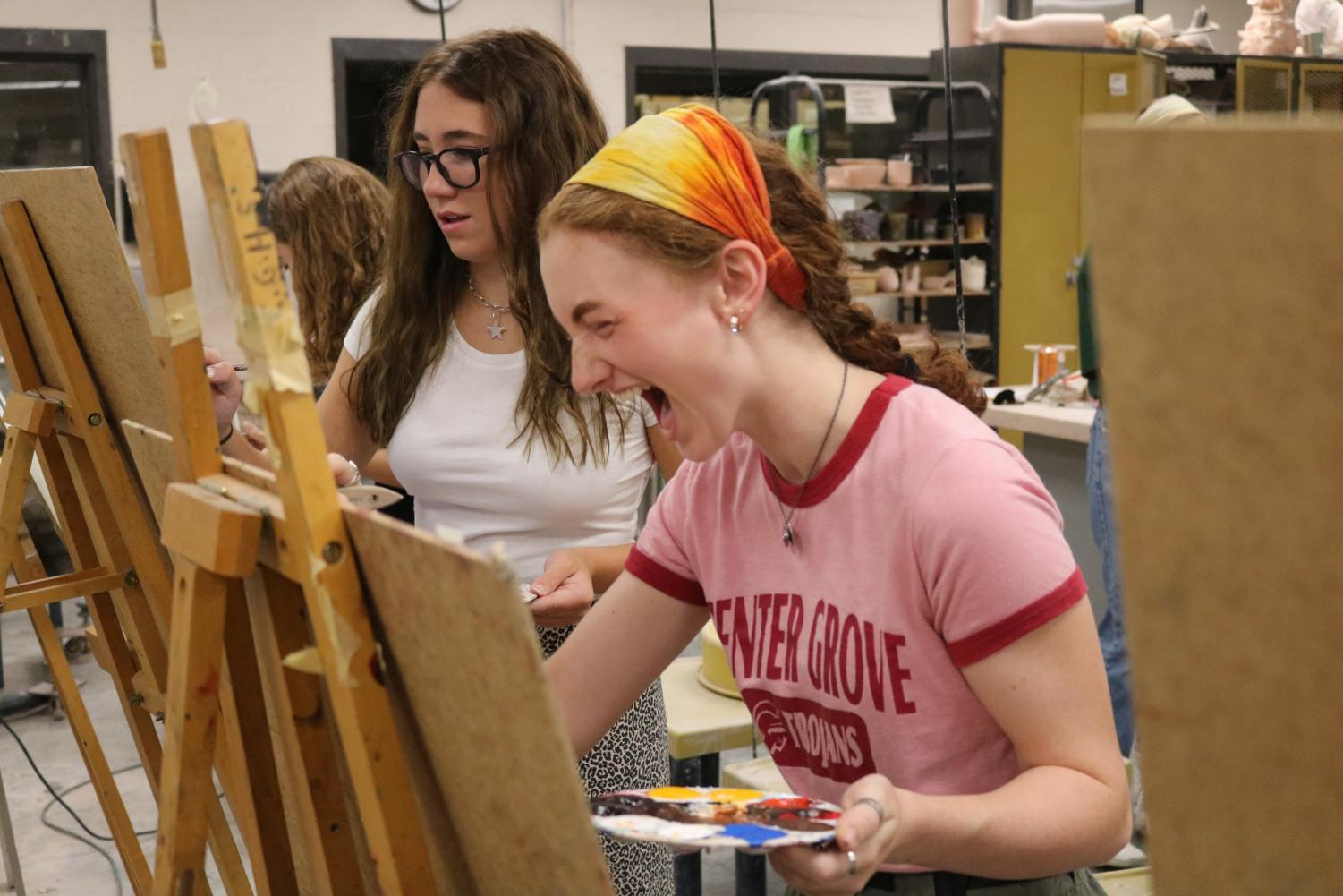 Seniors Emma Helweg and Madelyn Yaden compete during the first ever Classroom Clash in teacher Nathan Fry's AP Art class.