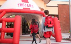 The inflatable Trojan helmet created a surprise entrance for students going into the Hall of Excellence before school.