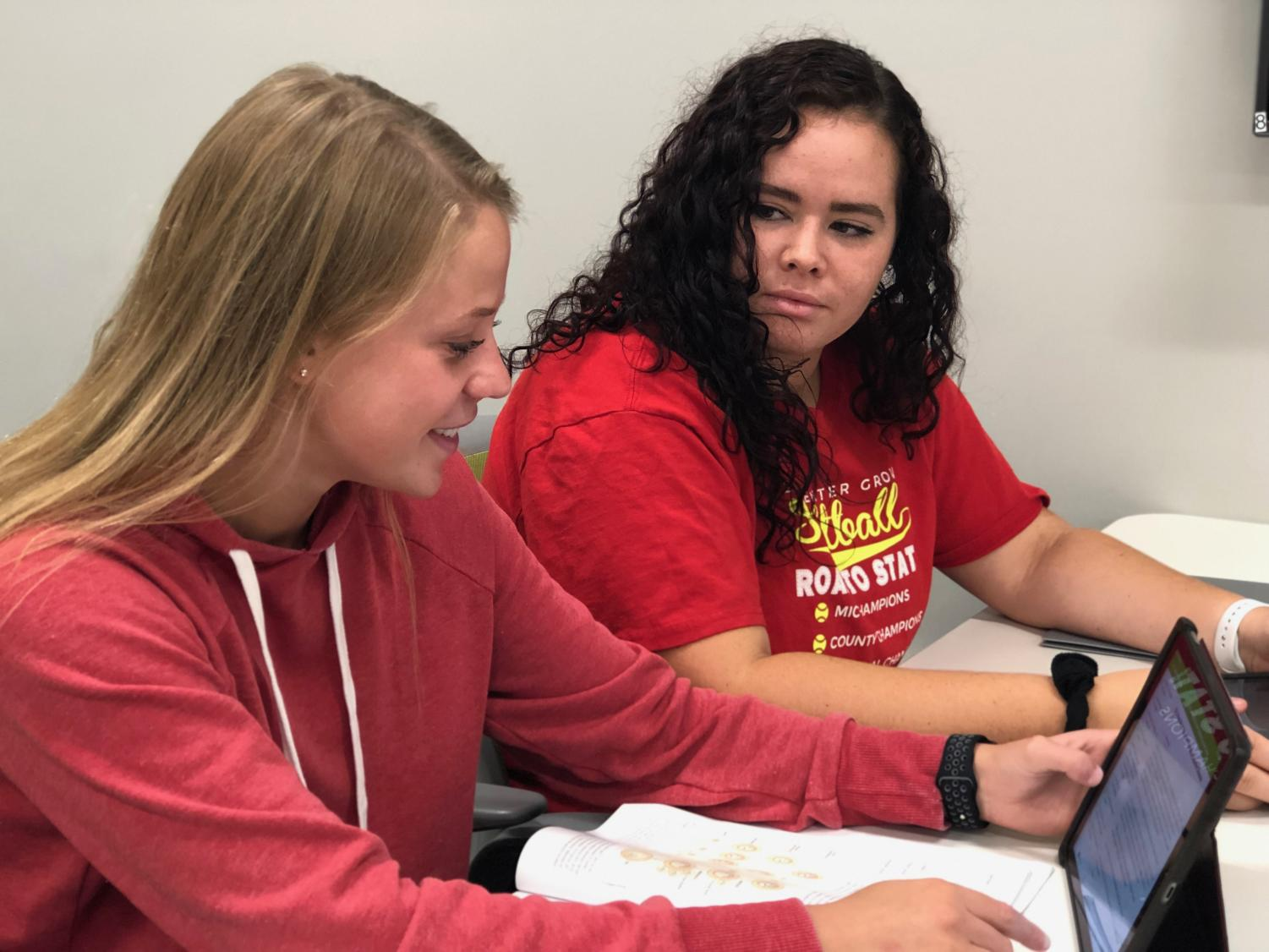 Seniors Paige Dwyer and Lexi Fair work in the Media Center. Once STaR changes to AIM, students will have choices where to go during the current STaR block on Mondays through Thursdays.