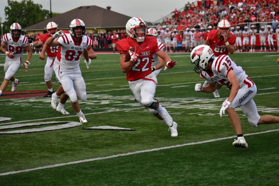 Junior Connor Fruits runs through the New Palestine defense.