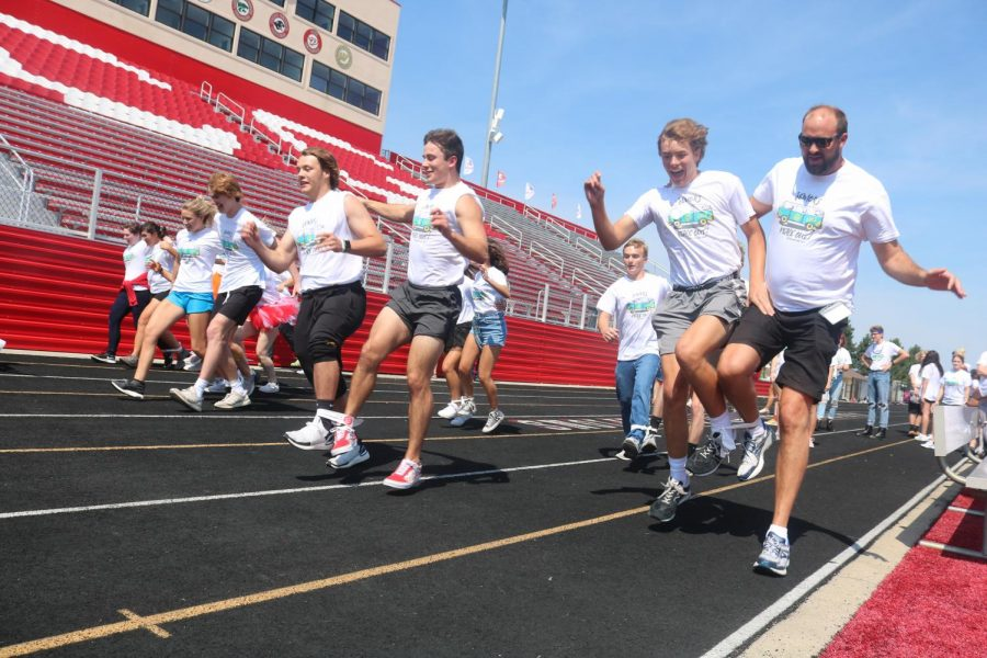 Seniors and teachers race on the track during the outdoor portion of the Senior Seminar.