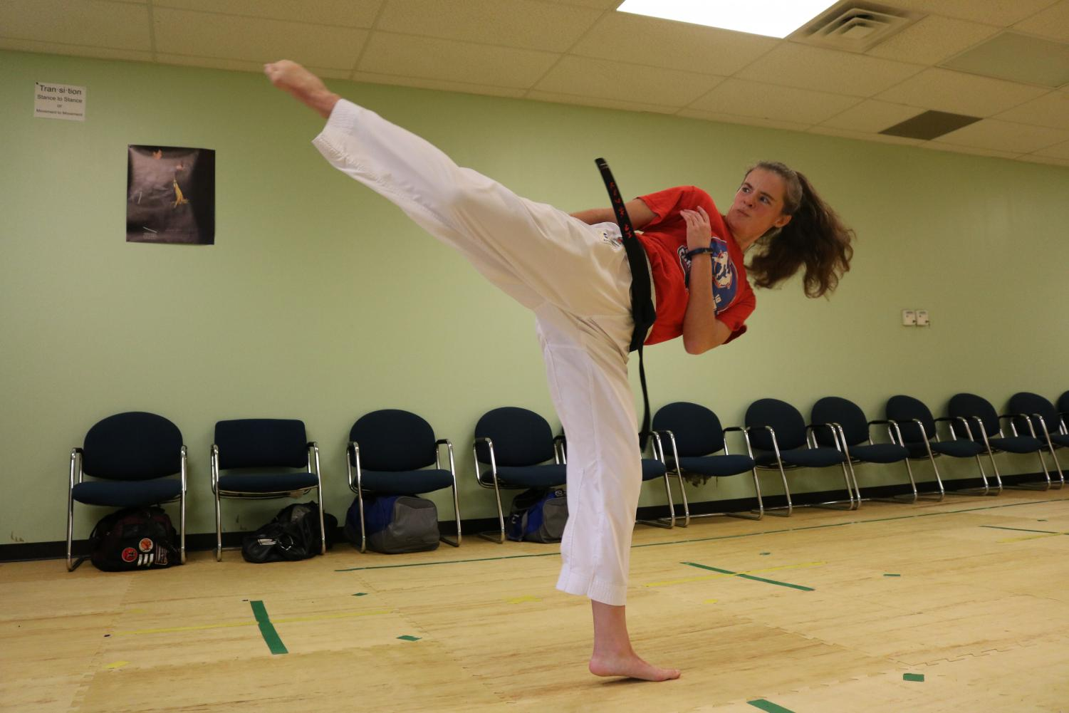 Sophomore Emma Bohanon practices a kick during karate training.