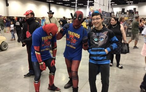 Charles Dowell stands with other attendees dressed in costume for the Indy Comic Con.
