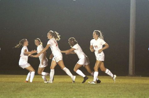 The girls soccer team celebrates during their game against Pike.