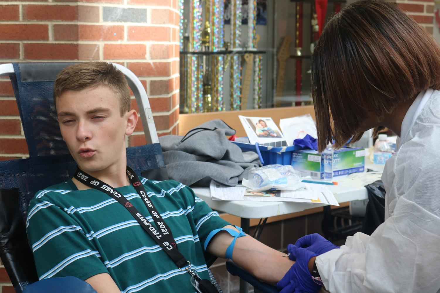 Noah Bowersox '21 gets blood drawn during Key Club Blood Drive. Photo by A. Gardner