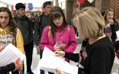 Junior Jolie Weilhamer checks out with Registrar Karen Cornett after taking the PSAT on Oct. 30.