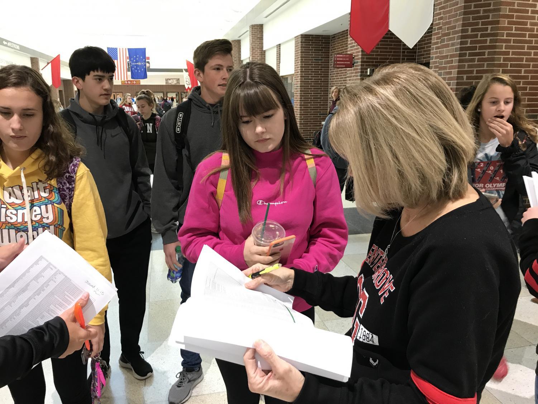 Junior Jolie Weilhamer checks out with Registrar Karen Cornett after taking the PSAT on Oct. 30.