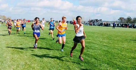 Archit Malik passes a Carmel runner during the Indiana state finals.
