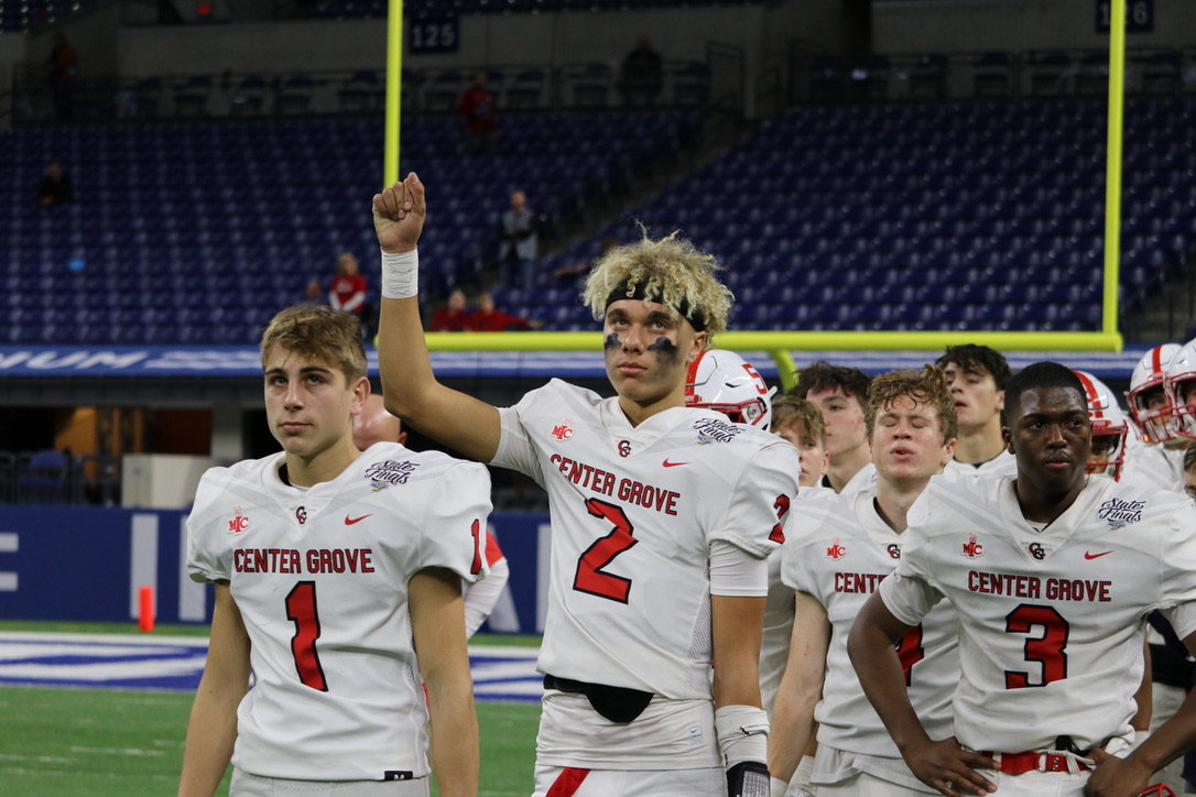 Week+of+Nov+29%3A+sophomore+quarterback+Tayven+Jackson+salutes+fans+alongside+his+teammates%0A%2C+freshman+running+back+Eli+Holt%2C+senior+safety+Elijah+Owens%2C+and+others+after+the+state+final.+The+Trojans+fell+to+the+Carmel+Greyhounds+17-20.