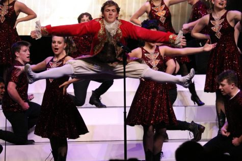 "Senior Ben Johnson does the splits in midair during ""Scene 5."""