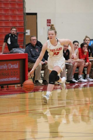 Junior Mary Wilson dribbles down the court.