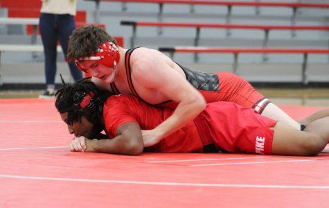 Drake Buchanan pins a wrestler from Pike High School.