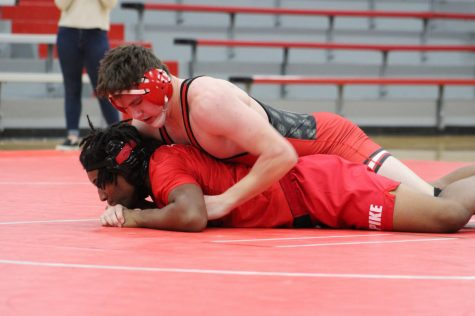 Drake Buchanan pins a wrestler from Pike High School.