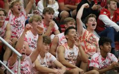 Members of the boys varsity soccer team cheer during the Homecoming pep rally.