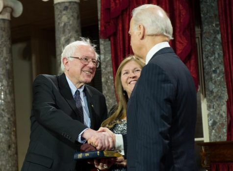 Senator Bernie Sanders and former Vice President Joe Biden shake hands in 2011.