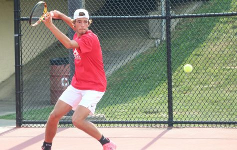 Carson Contos plays doubles with partner Landen Finlinson.