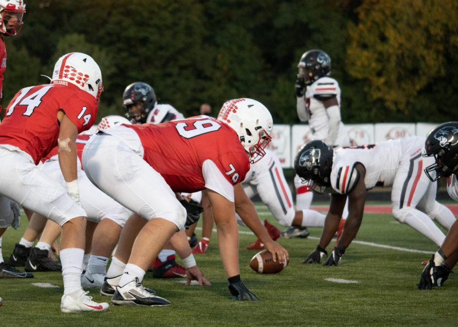 The Trojan offensive line stares down North Central the Panther defense in the team's 47-0 win.