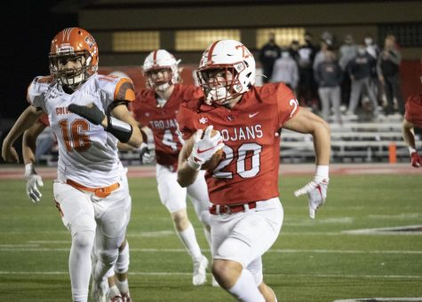Junior running back Mitchell Evans evades defenders in the Trojans