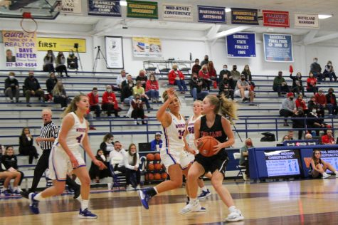 During the county championship game against Whiteland, Ella Hobson drives to the basket.