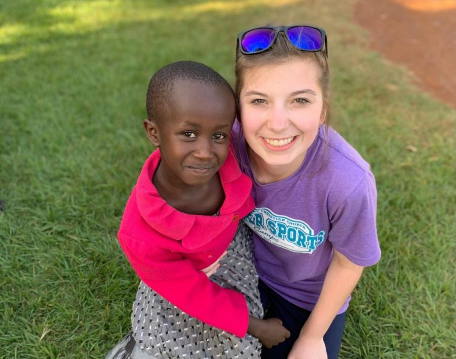 McLeish takes a photo with one of the Kenyan children she aided during her missionary work.
