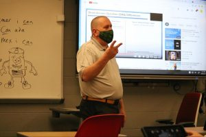Social studies teacher adapts ideas, skills from class into newspaper column