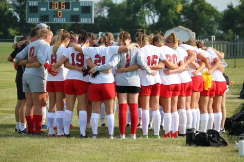 The girls soccer team huddles before its scrimmage against Zionsville last week.