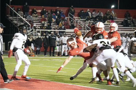Senior Caden Curry dives into the end zone, scoring his first career touchdown, in last years 38-0 regional championship victory over Warren Central.