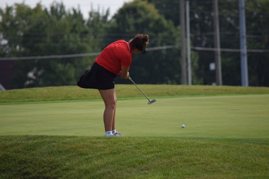 Lanie DeHaven putts from the edge of the green during tonight