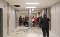 Students are evacuated from the science classrooms that began flooding during Wednesday's heavy rain.