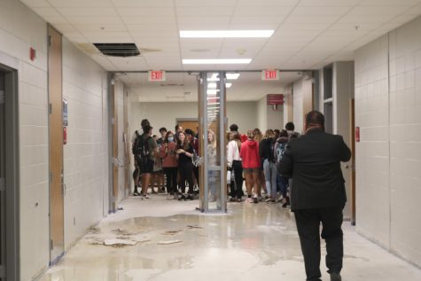 Students are evacuated from the science classrooms that began flooding during Wednesdays heavy rain.