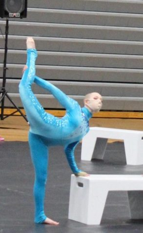 Callista McCullough performs at a color guard competition.