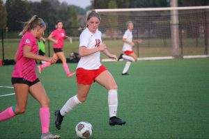 Senior Riley Williams defends Columbus North players in their 2-2 tie in the season opener.