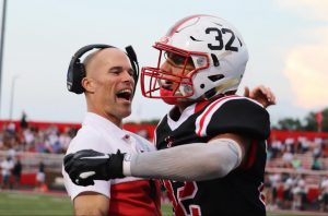 Coach Lyon Embraces James Schott after his fumble recovery in last week's 56-7 victory over Decatur Central.