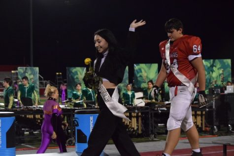 Workman walks off the podium after being declared sophomore homecoming princess.