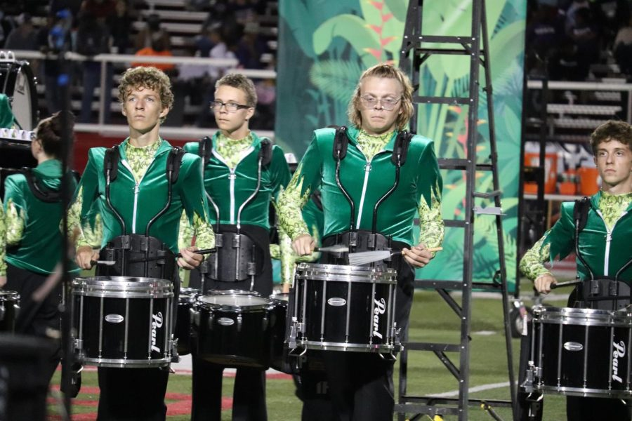 Members of the marching band perform during the halftime of the Ben Davis football game.
