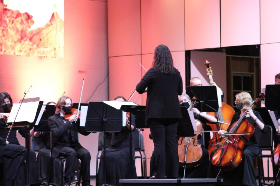 Conductor Laura Deaton conducts members of the orchestra during an October 6 performance.