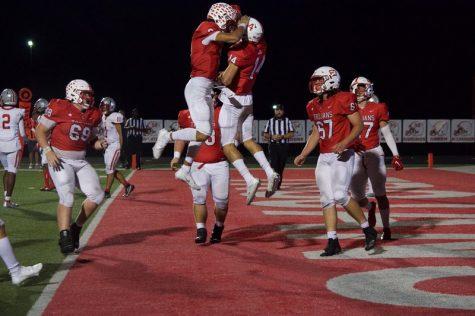 Trojans football team looks to close regular season with perfect record