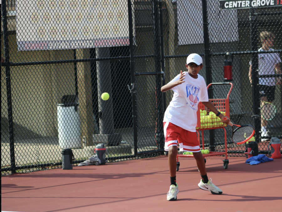 Freshman Daksh Patel swings his racquet during warmups against Park Tudor.