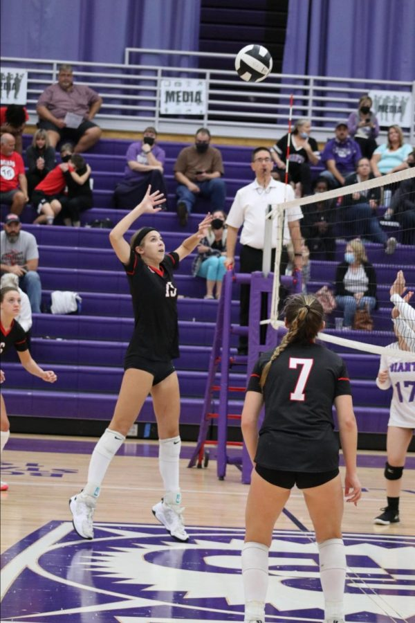 Freshman Reese Dunkle sets up for a kill against Ben Davis.
